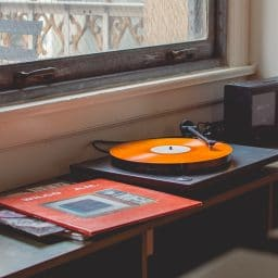 A vinyl record player.